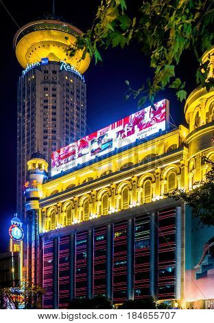 Shanghai, China - Nov 3, 2016: Night scene along Nanjing Road Pedestrian Street - New World Building with colorful lights.