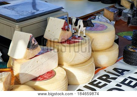 El Raso, Alicante, Spain - July 2, 2016: Different cheese in packs and in bulk on market counter, Mercadillo de Campo de Guardamar