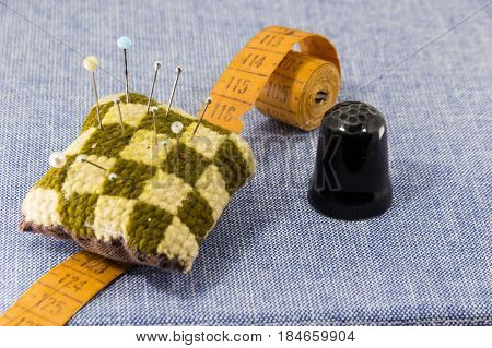 Beautifully Laid Out Accessories For Needlework On A Jeans Background