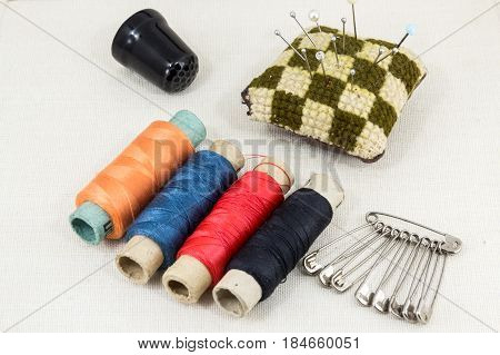Textile Fabric For Sewing,accessories For Needlework On New Textile Background. Spool Of Thread, Sci