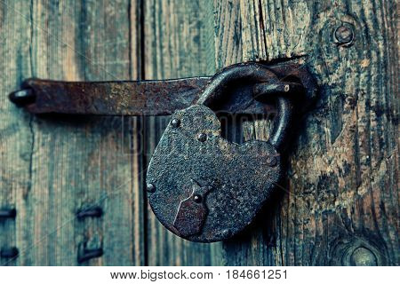 An old wooden door with an old lock. storehouse