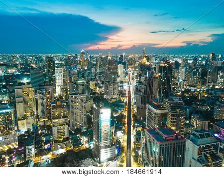Bangkok Thailand - May 1 2017: An aerial of view of downtown Bangkok Thailand at nighttime when the tall skyscrapers are illuminated.