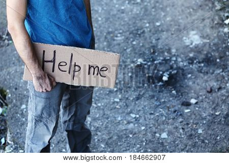 Man begging for help on the street