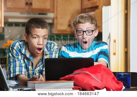 Shocked Teens Looking At Computer