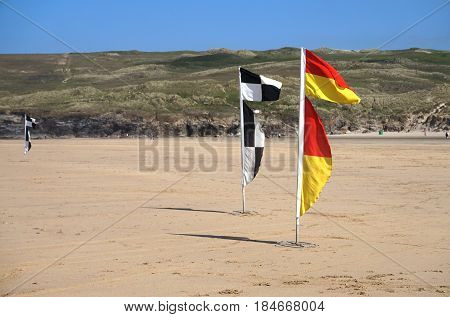 Newquay, Cornwall, Uk - August 7 2017: Warning Flags On The Beach For Swimmers And Surfers