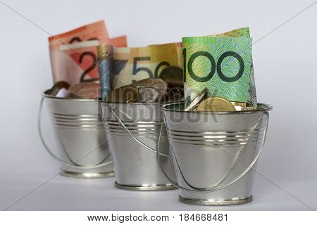 Buckets full of Australian dollar notes and mixed coins.
