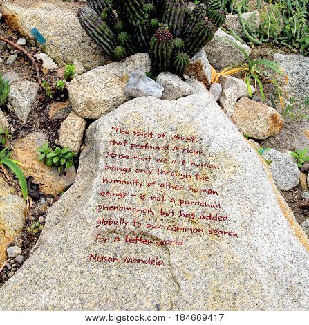 Bodelva, Cornwall, Uk - April 4 2017: Rock With Nelson Mandela Inscription About Humanity At The Ede