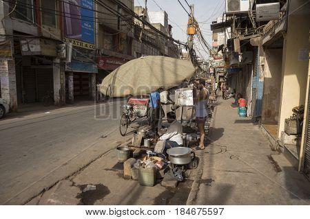 DELHI INDIA - JUN 11 : street tea stall at chawri bazar in old delhi of delhi on june 11 2015 india. milk tea or chai is popular beverage of indian people