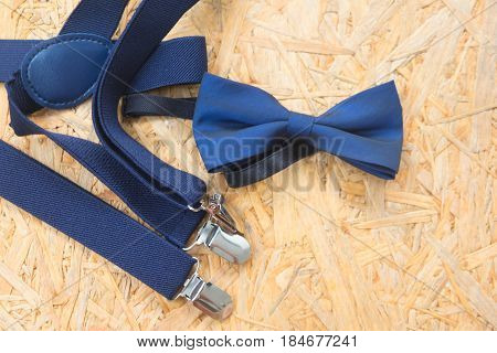 Mens wedding accessory blue bow tie on wood background