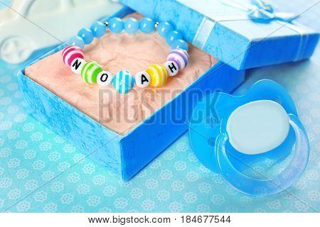 Bracelet with baby name Noah on blue background