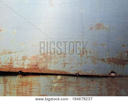 Background of a worn and rusty metal plate