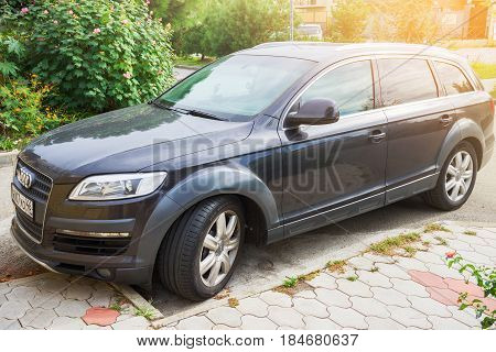 Sochi, Russia - October 11, 2016: Luxury Audi Q7 parked suburbia of Sochi City at sunny day.
