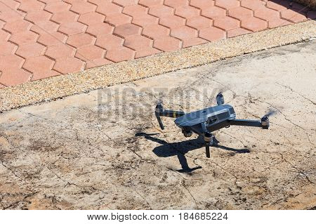 CHANBURI THAILAND - 11 APRIL 2017 - Unmanned aerial vehical with video camera hovers in the air. This is DJI Mavic Pro model.