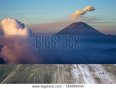 vintage wood terrace with view of Semeru mountain in Bromo tengger semeru national park East Java Indonesia copy space color tone effect soft focus selective focus.