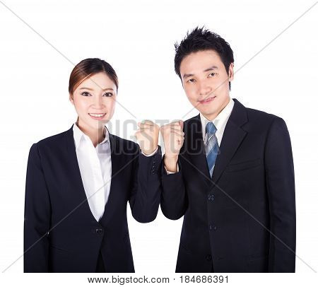 Successful Business Man And Woman With Arm Raised Isolated On White