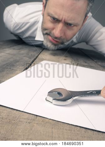 Business concept image with a concluding contract using a wrench and nut
