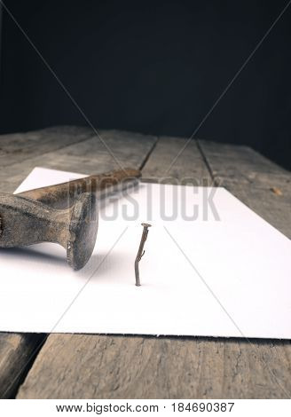 Business concept image with a concluding contract hammer and nail on contract