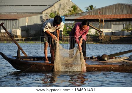Fisherman Fishing With Fishing Nest In The Mekong Delta, Vietnam