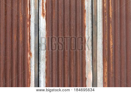 Dark Brown Used Zinc Or Rusty Zinc Wall For Background. Zinc Wall With Vertical Line For Text.
