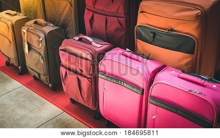 Luggage consisting of large suitcases rucksacks and travel bag. Travel luggage show case in shop.