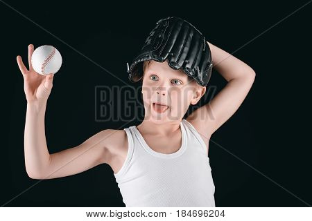 Portrait Of Grimace Boy With Baseball Equipment Isolated On Black