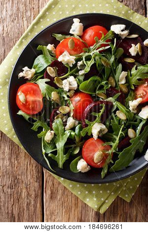 Healthy Salad With Beetroot, Arugula, Tomatoes, Roquefort Cheese And Seeds Close-up. Vertical Top Vi