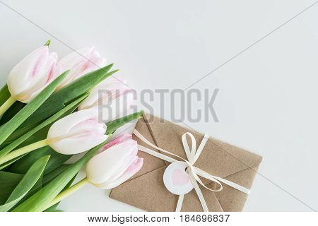 Light Pink Tulips And Envelope Isolated On White With Copy Space, Wedding Cards Flowers Concept