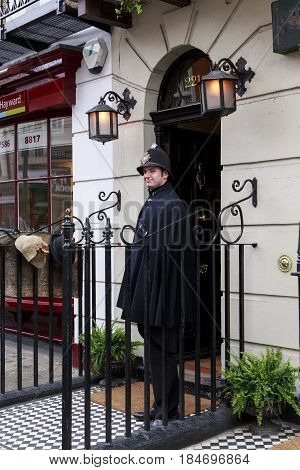 LONDON, GREAT BRITAIN - MAY 11, 2014: This is artist-policeman at entrance to the Sherlock Holmes Museum on Baker Street 221B.