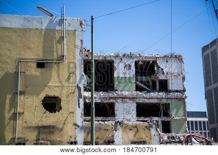Demolition house in Munich bricks bulldozer industrial