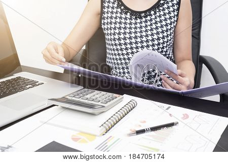 business accountants with documents graph financial on office table. concept planning budget audit.