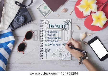 Summer Beach Fun vacation Concept.people list planner trip on notebook.