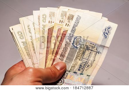 Hand holding Russian rubles stock image. Minimal wage stock image.