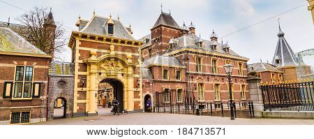 Hague, Netherlands - April 5, 2016: Arch to Binnenhof palace, place of dutch parliament in Hague or Den Haag, Holland, Netherlands