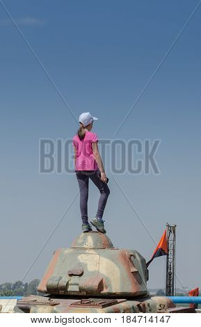 Unidentified girl stand on tank armo at Latrun Armored Corps Museum