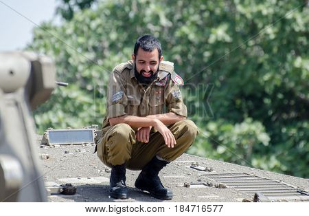 Unidentified Israeli Soldier Sit On Tank Armour At Latrun Armored Corps Museum