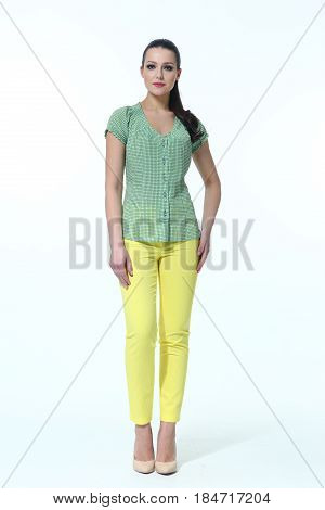 indian woman in summer yellow trousers and green tshirt full body length high heeled shoes back shot isolated on white