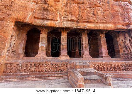 Stairs to 6th century cave Hindu temple architecture landmark in Badami, India.