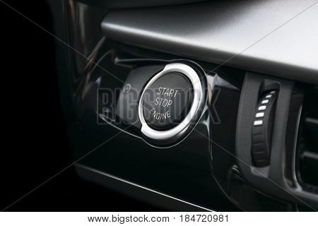 Car dashboard with focus on engine start stop button car interior details