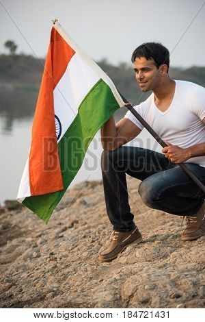 indian man holding indian flag or tricolour