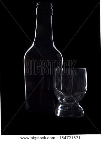 Glass and bottle wine on black background