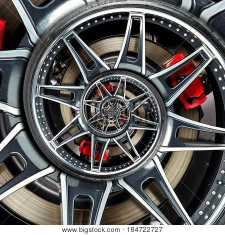 Sport car automobile wheel abstract fractal brake disk tire close up spiral effect pattern background illustration. Automotive abstract car wheel tire spiral pattern background. Car wheel metal spokes