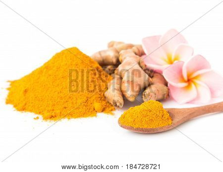 Closeup turmeric powder and turmeric roots on white background for spa skin care beauty concept