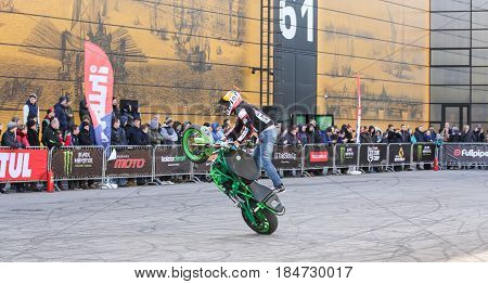 St. Petersburg Russia - 15 April, Moto freestyle on a green bike,15 April, 2017. International Motor Show IMIS-2017 in Expoforurum. Sports motorcycle show of bikers on the open area.