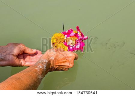 Doing puja at the river Ganges in India