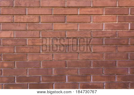 Background of the red brick wall with horizontal masonry