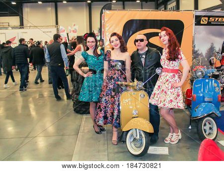 St. Petersburg Russia - 15 April, Photo with models at the scooter,15 April, 2017. International Motor Show IMIS-2017 in Expoforurum. Visitors and participants of the annual moto-salon in St. Petersburg.
