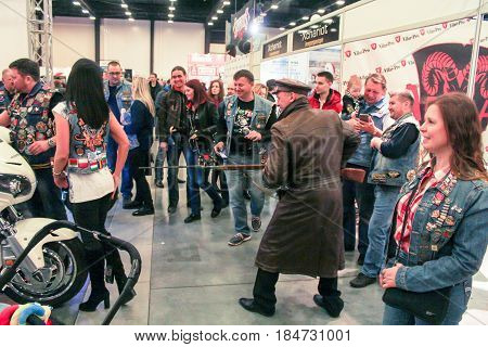 St. Petersburg Russia - 15 April, A revolutionary with a rifle among the visitors,15 April, 2017. International Motor Show IMIS-2017 in Expoforurum. Visitors and participants of the annual moto-salon in St. Petersburg.