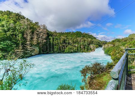 The Huka falls are the largest fast and powerful waterfalls on the Waikato River located in Wairakei Park of Taupo North Island of New Zealand