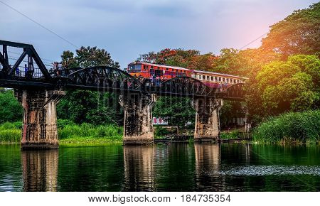 kANCHANABURI THAILAND - May 2017: The train is running on the World War II bridge in Kanchanaburi.