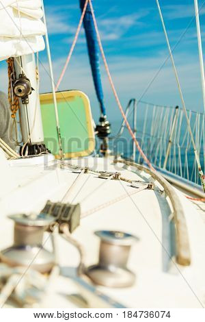 Yacht capstan with rope on sailing boat during cruise marine objects concept.